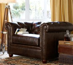 Retaining all the fine points of its Edwardian original, our Chesterfield Armchair is the perfect place to relax. It features sheltering arms and deeply tufted upholstery with top-grain leather that's weathered and antiqued for a supple feel.