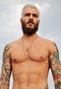 nipple piercing, tattoos, beard... :)