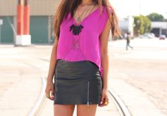 Fuchsia + leather mini + body chain. Edgy spring outfit.