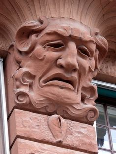 If you peek above the door of Skeppsbron 44 in the Old Town of Stockholm, you'll see a stone face sporting an exaggerated expression - a potent mix of despair, disgust, and rage. And below the grimace, if you look carefully, you'll spot...something else. Is that..? Oh yes. Yes it is. Learn more at AtlasObscura.com