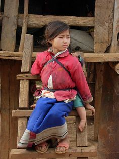 Young Girl, Phonsavan, Laos. The Lao people are incredibly kind and welcoming but at the same time shy and cautious of us visitors. by Lorna87