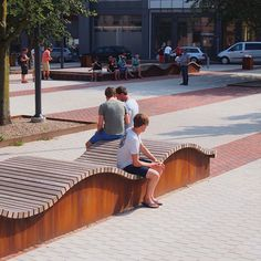 Playful Platform Seating Elements with Undulating Waves made of FSC Hardwood