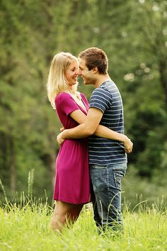 Profile shot of romantic couple kissing in field