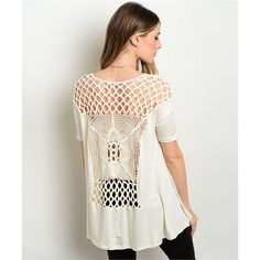Crochet All Day Ivory Top It's all about the details with this Crochet All Day Ivory top. Basic and innocent in the front and then a boho party in the back! This lightweight knit top features a relaxed fit, short sleeves, hi-low hem and crochet back. Pair it with distressed denim shorts and gladiator sandals for a summer look!. . . If you're would like to make an offer, please use the OFFER BUTTON. {10% discount on all 2+ orders} . . FOLLOW US✌🏽️ Insta 📸: shop.likenarly Facebook📱…