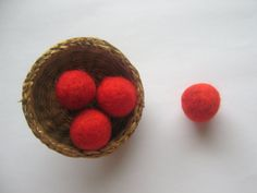DIY Merino wool felt beads in red for a creative craft project. They are just so beautiful and made of 100% pure wool. I manually needle felt