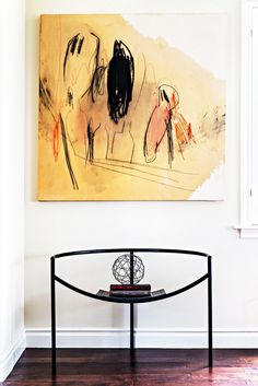Contemporary, sculptural chairs with artwork.