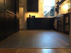Vinyl floor in a kitchen grey stone effect Kitchen Grey, Grey Kitchens, Luxury Vinyl Flooring, Luxury Vinyl Tile, Fired Earth, Vinyl Tiles, Grey Stone, Stone Tiles, Tile Floor