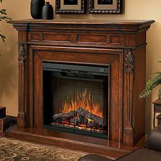I am so going to buy this for the new townhome bedroom!!!!!!!      Dimplex Torchiere Burnished Walnut Electric Fireplace Mantel Package - SEP-BW-4217-FB