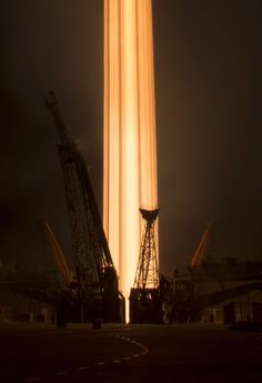How a long-exposure rocket launch photo spawns greatness     - CNET Reddits Photoshop battles forums can be amazing turning one photo into several different things.   Reddit user -WhistleWhileYouLurk recently posted a long-exposure photo of the Soyuz rocket launch which is headed for the International Space Station. Redditors pounced on it immediately with a ton of cool looking tweaked images. One even created a GIF to show how he/she created a movie poster which I put at the bottom of the…
