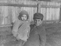 Children in Kovno Ghetto. A young boy holding a baby girl in the Kovno Ghetto.