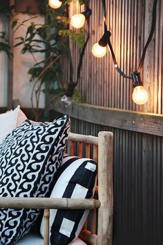 String lights accent a wall in an outdoor space