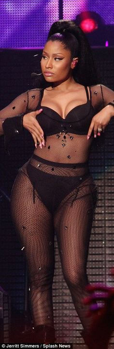 Super Bass: The 32-year-old hitmaker gyrated in a black mesh one-piece showcasing her ample cleavage and pert posterior