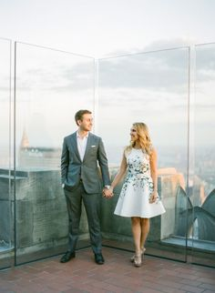 At the Empire State Building: http://www.stylemepretty.com/new-york-weddings/new-york-city/2015/07/10/romantic-golden-hour-nyc-engagement-from-kt-merry-photography/ | Photography: KT Merry - http://www.ktmerry.com/