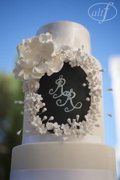Monogram on a Chalk Board Cake. Italian Style Wedding Ideas. Long Banquet Tables Las Vegas Wedding Planner Andrea Eppolito Wedding at Bellagio Las Vegas Photo by Altf