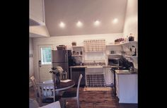 Farmhouse country kitchen with open shelving.  Fully equiped kitchen.    Charming cottage rental.  Mena Arkansas