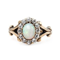 Exquisitely Handcrafted Victorian Era Opal Engagement Ring with Glittering Halo Engagement Ring Buying Guide, Vintage Engagement Rings, Vintage Rings, Vintage Jewelry, Diamond Are A Girls Best Friend, Yellow Gold Rings, Diamond Cuts, Jewelery, Jewelry Accessories
