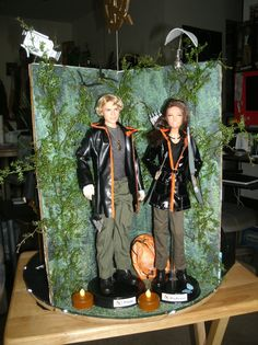 Hunger Games Barbie dolls of Katniss and Peeta for centerpiece contest at Hunger Games convention. Won first place!