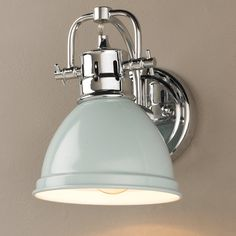 """A simple yet classic style in vibrant and traditional colors. This 1 light sconce will add a crisp clean look to your home. A great choice for  traditional, beach, cottage, or contemporary decor. Hardware is available in three finishes: Bronze and Chrome or Pewter with your choice of metal enameled shades in Black, Blue, Red, Seafoam, and White or plated shades in Chrome and Pewter.UL listed Damp location. Can be installed either up or down. (8.5""""Hx6.5""""Wx8.25""""Ext)100 watt mediu..."""