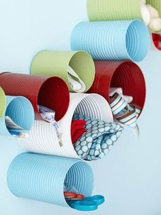 DIY - Old soup cans + spray paint = Wall storage whimsical decoration. What a fun idea, great for a home studio or kids space, or for tight unused closet space. Sewing / crafts/ art would fit perfectly here. Just make sure to get the smells out. Cheap Home Office, Home Office Storage, Home Office Organization, Organization Ideas, Wall Storage, Craft Storage, Storage Ideas, Recycling Storage, Storage Solutions