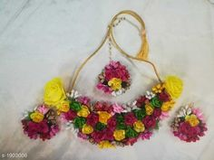 Jewellery Set Floral Handmade Women's Jewellery Set  *Material* Foam  *Size* Free Size  *Description* It Has 1 Piece Of Necklace , 1 Piece Of Maang Tikka & 1 Pair Of Earring  *Work* Artificial Flower & Beads Work  *Sizes Available* Free Size *   Catalog Rating: ★4.1 (1805)  Catalog Name: Floral Handmade Women's Jewellery Set CatalogID_250850 C77-SC1093 Code: 252-1903006-