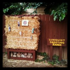 This is the finished bb gun shooting range. Very inexpensive project. The hay was just under 20 bucks and the wood was scrap (free). There are slats on top of the hay so my boys can hang cans and action figures. I filled in the open space with rocks because I thought it would look unique. The sign is a nice touch that the kids really like too. As always, if you do something like this, please teach your kids gun safety and be very strict about it.