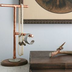 Make this jewelry display from copper pipes and fittings.