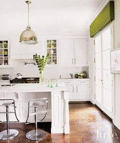Beautiful white kitchen with pops of green