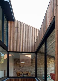Cutaway Roof House by Scale Architecture has a courtyard sliced out of one side