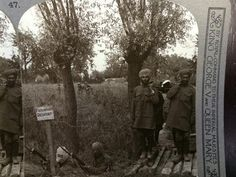 Two Sikh soldiers carrying a stretcher on the Western Front, two Indian soldier with gas masks in the trenches. WW1