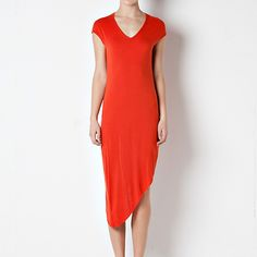 09/12/14 ISD2277 Basic Rounded Long Dress w/Asymmetrical Side in 2 colors (Black or Rust). Available in S, M or L. 96% Rayon, 4% Spandex. Model in Rust