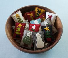Wool Felt Balsam Pillows - Great bowl fillers and holiday party favors! Wool - 5 Ways To Make Money Christmas Applique, Felt Christmas Ornaments, Christmas Sewing, Christmas Embroidery, Primitive Christmas, Christmas Crafts, Christmas Decorations, Christmas 2015, Felted Wool Crafts