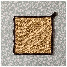 Angkor Wat Dishcloth - Angkor Wat is a moated temple in Cambodia, which has absolutely nothing to do with a dishcloth except for the fact that it's a very beautiful set of buildings surrounded by water, much like this dishcloth is a pretty stitch pattern surrounded by applied icord.