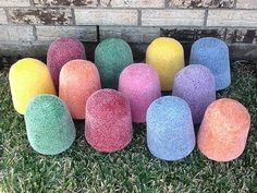 Make large gumdrops out of plastic sand pails. Simply coat the outside of each pail with spray-on glue then sprinkle on clear glitter to give them the sugary look of a gumdrop. Allow the pails to dry completely then turn them upside down and place them in clusters or along the pathway. (inspiration only - no link)