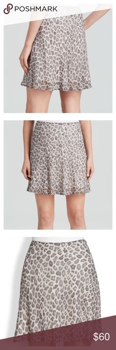 NWT Joie Embellished Silk Animal Print Skirt NWT Elegant and feminine silk skirt by Joie. Has beading sporadically throughout and comes with a bag of extra beads. Had invisible zipper on the back and the hem falls down in a light wave/ruffle. Very subtle all around but a great way to turn an otherwise boring business casual outfit into something fun and sexy. Joie Skirts