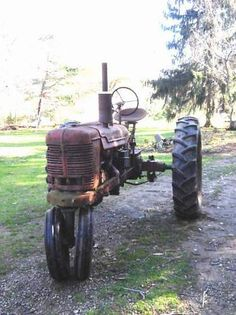 Old Farmall tractors.... I think we had that tractor.. hmmm