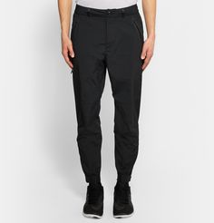 Nike's 'NikeLab White Label' collection has been designed with comfort and ease in mind. Made from the brand's tech woven shell, these trousers are water-repellent and reinforced with coated seams to keep you dry in unfavourable conditions. They taper at the ankles and have zipped elasticated cuffs for a sporty finish. Shown here with a Nike sweatshirt and sneakers and Acne Studios shirt.