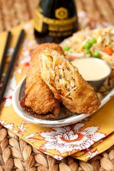 Pork Egg Rolls Ground pork, stir fry cabbage, carrots, and onions. Roll them and fry in vegetable oil and dip in teriyaki and soy or sesame ginger dressing and soy.