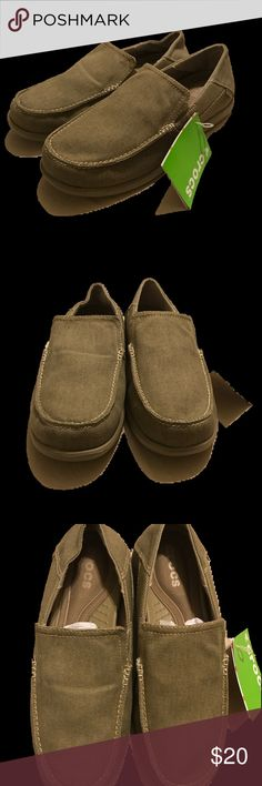 """Men's Crocs Khaki Slip ons. Men's Crocs size 10 worn canvas standard fit Crocs Style: Santa Cruz 2 luxe stitched canvas ***No Box Sz 10 (approx 10.625"""") NWT, never worn canvas Crocs Style: Santa Cruz 2 luxe stitched canvas  Sz 10 about 10.625""""  SHOE FEATURES Memory foam pillows on top of a Croslite foam base Sink-in softness with the resilient bounce-back of Croslite material SHOE CONSTRUCTION Canvas upper Fabric lining Croslite midsole and outsole SHOE DETAILS Moc toe Slip-on Memory foam on…"""