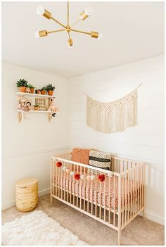Baby Girl Pink Bohemian Floral Botanical Nursery | Shiplap Pom Poms Macrame Potted Plants Shag Rug Crib | Rifle Paper Co. | Light Natural Wood
