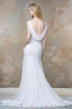 Meticulous attention to detail, trendynude illusion necklines and plunging backs,soft and luxurious fabrics, these sophisticatedwedding dresses from Ellis Bridals quintessentially express and enhance a bride'sindividual beauty, having her feeling feminine andunderstatedly sensual.