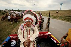 Photograph by Aaron Huey    In 2006 Oliver Red Cloud, now 94 years old, sits in the back of the pickup leading the annual Oglala Nation Pow Wow parade in Pine Ridge, South Dakota.
