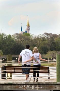 Walt Disney World engagement photo in front of the castle with personalized Disney bride and groom t-shirts