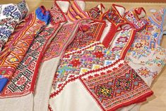 A collection of traditional 'sorochkas', or shirts,  embroidered in various local styles popular in the ethnographic region of Pokuttya in Carpathian Western Ukraine, and in particular Horodenka raion villages such as Serafyntsi, Yaseniv-Pil'nyi, Hlushkiv, Chernyatyn, Tyshkivtsi, Chortovets', Kotykivka, Stril'che, Potochyshche, Semakivtsi, Korniv, Vikno, Toporivtsi, Soroky, and Verbivtsi. (Hand embroidered by Dave Melnychuk)