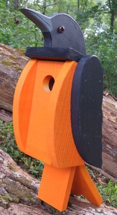 Beautiful handmade & painted Baltimore / Northern Oriole Solid Wood Bird House What an awesome, unique bird house. Extremely solid piece looks fantastic mounted on a fence post, etc. Beautiful enough
