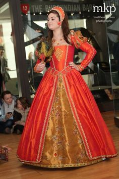 The show was presented in the amazing Tournament Gallery at the Royal Armouries in Leeds  - Henry VIII's armour is clearly visible behind the models – it was a superb venue. This is the orange firefly costume