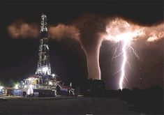 This is a pic taken by someone who works on an oil rig. He was going to take a pic of the lightning and was unaware of the tornado until the lightning illuminated it.