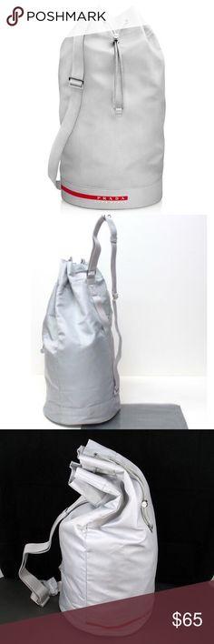 b8283b373e04 Prada Luna Rossa draw string bucket bag Bag is a light grey