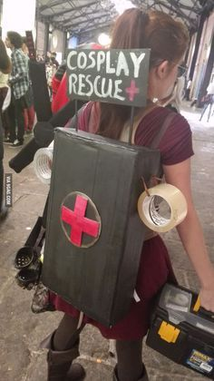 This girl in Costa Rica is helping cosplayers. In her back there are glue, scissors,  tape,  etc...