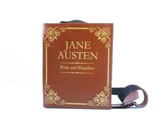 """This leather purseis made in a shape of a book. """"Pride and Prejudice"""" by Jane Austen. PRODUCT STORY Our LiteraryBags collection includes the most popular book titles as well as favoritebooks of our customers made to order. FEATURES  Made of genuine leather Magnet snap closure Adjustable two-layer shoulder strap (leather/nylon strap) up to 50"""" Twoinner pockets Bag is fully lined (lining may differ from the one on the pictures) Reinforsed and padded for extra durability  WE ACCEPT CUSTOM…"""