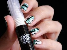 Black white and turquoise aztec pattern nails